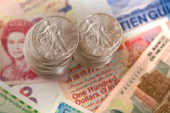 International currency and walking libery silver Royalty Free Stock Image
