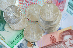 International currency and walking libery silver Royalty Free Stock Images