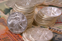 International currency and walking libery silver Stock Photos