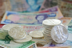 International currency and walking libery silver Stock Photography