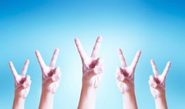 International Day of Cooperatives concept: human hands showing v-sign. World water day concept: protect the Earth stock photography