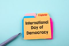 International Day of Democracy 15 September. Business, technology Concept. Paper note with text royalty free stock photo