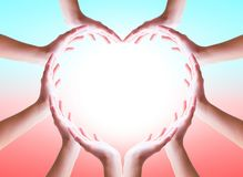International Day of Friendship concept: hands in shape of heart on blurred  background royalty free stock photos