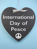 International Day Of Peace Message Written On Heart Shape Blackboard Stock Photo