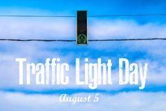 International Day of Traffic. 5th of August. A traffic light against the sky. International Day of Traffic. 5th of August. A traffic light against the sky stock images