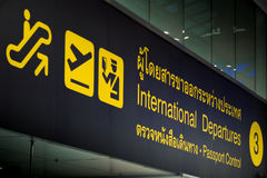 International  Departure & Passport control sign in airport. Yellow international  departure & passport control sign in international airport Royalty Free Stock Photos