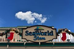 International Drive area. Seaworld Store sign with Christmas ornaments on blue cloudy background in International Drive area. Orlando, Florida. November 19 royalty free stock photos