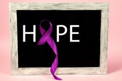 International Epilepsy Day. International or world Epilepsy Day concept. The text and a purple ribbon on a on advertising board. The health, breast, awareness royalty free stock images