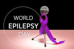 International Epilepsy Day. International or world Epilepsy Day concept. The text and a purple ribbon with microphone on a pink background. The health, breast stock photography