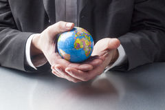 International export manager traveling across the globe Stock Image