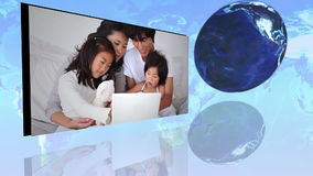 International families using internet with an Earth image courtesy of Nasa.org stock video footage