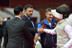 International fencing tournament St. Petersburg Foil 2015. St. Petersburg, Russia - May 3, 2015: Italian team handshakes with judges after team semifinal of 41th Stock Photo