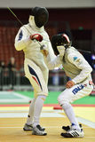 International fencing tournament St. Petersburg Foil 2015. St. Petersburg, Russia - May 2, 2015: Lorenzo Nista of Italy vs Jordan Moine of France in 1/32 final Stock Photo