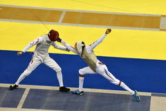 International fencing tournament St. Petersburg Foil 2015. St. Petersburg, Russia - May 3, 2015: Team semifinal match China vs France during 41th International Stock Image