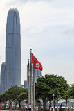 International Finance Centre and Hong Kong flag Royalty Free Stock Images