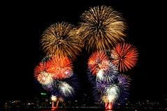 International firework in Pattaya, Thailand. Firework has the colors like Thai flag Stock Photo