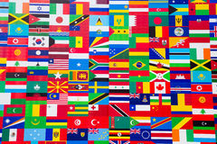 International Flag Display of Various Countries. Photo of printed flag displays showing the various countries of the world in an abstract wallpaper pattern Royalty Free Stock Photos