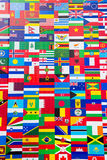 International Flag Display of Various Countries. Photo of printed flag displays showing the various countries of the world in an abstract wallpaper pattern Stock Photos