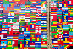 International Flag Display of Various Countries. Photo of printed flag displays showing the various countries of the world in an abstract wallpaper pattern Stock Images