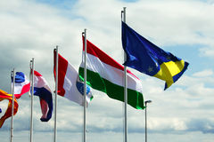 International flags. Against cloudy sky stock photo