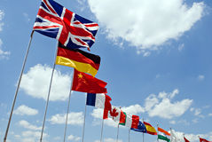 International Flags. Waving flags representing different countries with blue sky background Royalty Free Stock Photo
