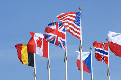 International Flags. National flags on display for the countries of the United State, United Kingdom, Canada, Belgium, Czech Republic, Norway and Poland royalty free stock photo