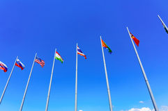 International flags against blue sky Royalty Free Stock Photography