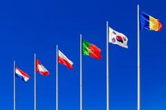 International flags against a blue sky Royalty Free Stock Photos