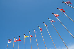 International Flags against sky Stock Images