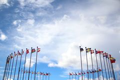 International flags against the sky Stock Image