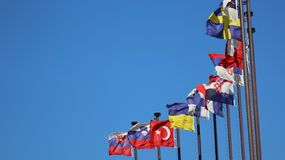 International flags against the sky Royalty Free Stock Photo