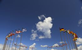 International flags on a background of clouds Stock Photography