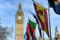 International flags in front of Big Ben, London. Row of International flags in front of Big Ben, London, the iconic clock tower of the old Westminster palace at Royalty Free Stock Photo