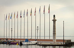 International. Flags multicolor on the lake Stock Image