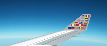 International flags, plane. Panorama above the sky Royalty Free Stock Photos
