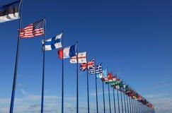 International flags on sky background Stock Photo