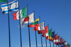 International flags on sky background Stock Photo