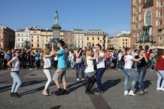 International Flashmob Day of Rueda de Casino, 57 countries, 160 cities. Several hundred persons dance Hispanic rhythms on the Ma. In Square in Cracow. Poland Royalty Free Stock Photo