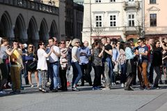 International Flashmob Day of Rueda de Casino, 57 countries, 160 cities. Several hundred persons dance Hispanic rhythms on the Ma. In Square in Cracow. Poland Stock Photo