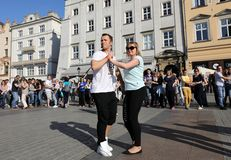 International Flashmob Day of Rueda de Casino, 57 countries, 160 cities. Several hundred persons dance Hispanic rhythms on the Ma. In Square in Cracow. Poland Stock Photos