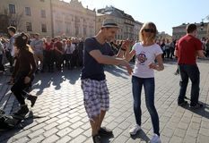 International Flashmob Day of Rueda de Casino, 57 countries, 160 cities. Several hundred persons dance Hispanic rhythms on the Ma. In Square in Cracow. Poland Royalty Free Stock Photography