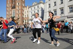 International Flashmob Day of Rueda de Casino, 57 countries, 160 cities. Several hundred persons dance Hispanic rhythms on the Ma. In Square in Cracow. Poland Royalty Free Stock Image