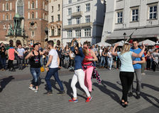 International Flashmob Day of Rueda de Casino, 57 countries, 160 cities. Several hundred persons dance Hispanic rhythms on the Mai Royalty Free Stock Photos