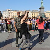 International Flashmob Day of Rueda de Casino, 57 countries, 160 cities. Several hundred persons dance Hispanic rhythms on the Mai Royalty Free Stock Images