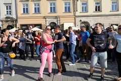 International Flashmob Day of Rueda de Casino, 57 countries, 160 cities. Several hundred persons dance Hispanic rhythms on the Ma Stock Image