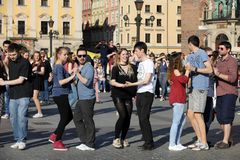 International Flashmob Day of Rueda de Casino, 57 countries, 160 cities. Several hundred persons dance Hispanic rhythms on the Ma. In Square in Cracow. Poland Royalty Free Stock Images