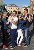 International Flashmob Day of Rueda de Casino, 57 countries, 160 cities. Several hundred persons dance Hispanic rhythms on the Ma. In Square in Cracow. Poland Stock Photography