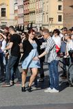 International Flashmob Day of Rueda de Casino, 57 countries, 160 cities. Several hundred persons dance Hispanic rhythms on the Ma. In Square in Cracow. Poland Stock Images