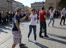 International Flashmob Day of Rueda de Casino, 57 countries, 160 cities. Several hundred persons dance Hispanic rhythms on the Ma. In Square in Cracow. Poland Stock Image