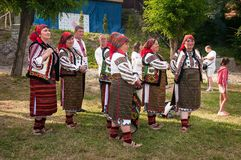 Hutsuly in folk costumes. Ukrainian people in traditional costumes on holiday. Stock Image